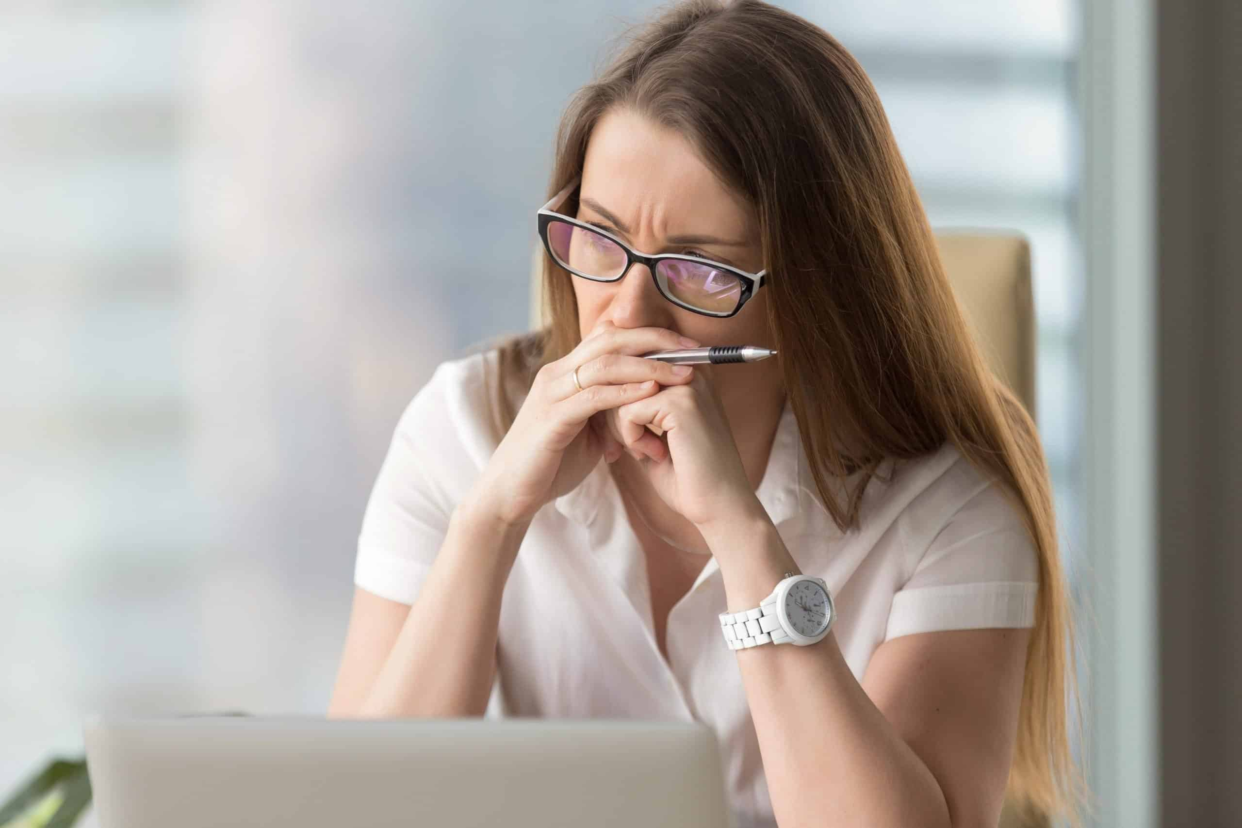 Pensive businesswoman thinking about problem